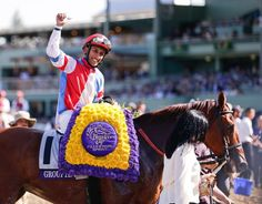 Jockey Rajiv Maragh celebrates after Groupie Doll wins the Breeders' Filly & Mare Sprint horse race. (Gregory Bull/AP)