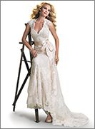 Bronwyn - by Maggie Sottero - A dreamy lace and tulle slim line gown with V-neckline and cap-sleeves features a separate slip gown of Vogue Satin to be worn below. The alluring open back is finished with a covered button over zipper closure. Includes a detachable satin ribbon belt. COLORS AVAILABLE All White, All Ivory, Ivory over Light Gold (shown)