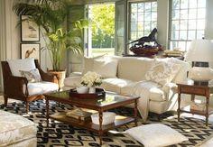 Dark wood, white fabrics and a modern rug