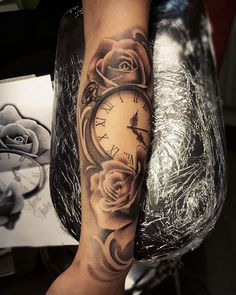 Pocket watch and roses tattoo More