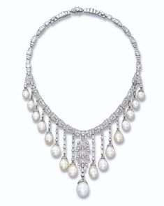 AN ART DECO NATURAL AND CULTURED PEARL AND DIAMOND NECKLACE   The fringe necklace designed as a series of pavé-set and baguette-cut diamond plaques suspending thirteen natural and four cultured drop-shaped pearls to the circular and baguette-cut diamond back, circa 1930, 44.0 cm long, with French assay mark for platinum