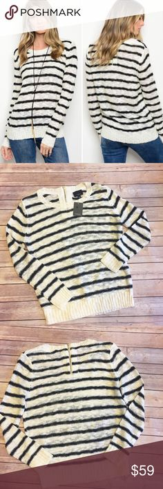 🎁JUST IN!!! Cream & Black Stripe Sweater S-L Oh.my.gosh. I love this sweater!!! Fabric content is 75% Acrylic & 25% cotton. Amazing feel, oversized fit and the zipper in the back is the icing on the cake. This is a must have! The small is in my photos and those are the bust & length on the small. Limited quantities so get yours now! No trades, no comments, only offer button. NWT Sweaters Crew & Scoop Necks