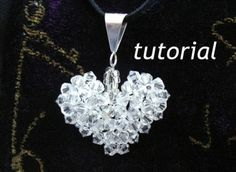 Jewelry Tutorial Pendant How to bead a Crystal Puffy Heart Pendant.  Learn how to make jewelry that looks original and handmade with a professional finish. No need for jewelry making classes with my step by step photo tutorial.  Jewelry making supplies :Swarovski Crystal Beads, Silver Bail,Chain,Monofilament thread  Clear Crystal Heart measures one inch diameter Purple Heart is one and a half inches diameter  Each heart has 73 swarovski crystals The larger crystal beads for the purple ...