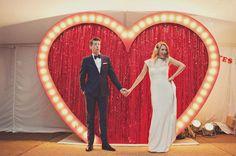 giant red wedding heart, love it.  cool wedding picture idea! #loveatfirstlight
