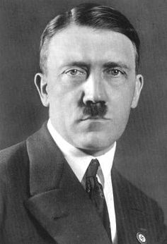 "Adolf Hitler was appointed Chancellor of Germany in 1933, becoming ""Führer"" in 1934 until his suicide in 1945.  By the end of the second world war, Hitler's policies of territorial conquest and racial subjugation had brought death and destruction to tens of millions of people, including the genocide of six million Jews in what is known as the Holocaust.  On 30 April 1945, Hitler committed suicide, shooting himself while simultaneously biting into a cyanide capsule."