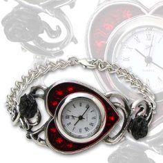 Dameklokke med flotte detaljer fra Alchemy of England.  Selve klokken ligger i et rødt emaljert hjerte med glitrende swarovski-krystaller bak.  #alchemyofengland #zendesign #klokke #armbånd #hjerte #swarovski