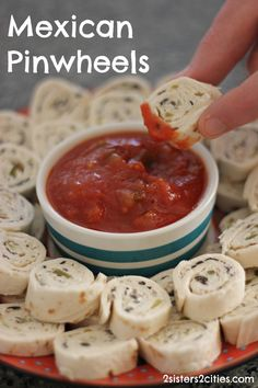 Mexican Pinwheels- a great game day appetizer!  Easy to make and you can make then ahead of time. Slice them up right before the game and serve them with salsa. {from 2 Sisters 2 Cities)
