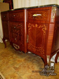 Vintage, marble top sideboard with gold inlay detailing. Measures 51*18*35.
