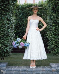 This tea-length Justin Alexander dress is oh-so-ladylike