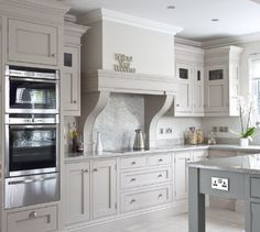 Grey And White Country Kitchen neutral kitchen space with dark elements and streamlined storage