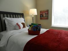 What little boy wouldn't love this sports/car themed bedroom?!