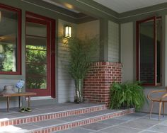 Possible paint color with red brick.  Like the light gray siding with darker trim.