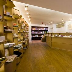 London designers Blustin Heath have designed a cardboard interior for the Magma Art Bookshop. Completed in August 2007 on Earlham Street in London, the entire shop including shelving systems, counter surfaces and changing rooms is made from treated cardboard. Cardboard shelves & cashier table.