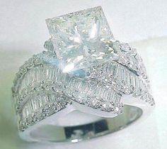 3.90 Karat platinum princess engagement ring: Princess diamond in the center set with 52 baguette & 54 round cut diamonds on the ring setting.