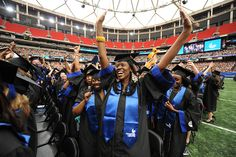 2012 GSU Spring Commencement  New graduates celebrate on the floor of the Georgia Dome.