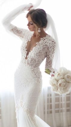 Daring, but GORGEOUS wedding gown.