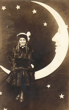 Adorable little girl, in her Sunday Best, on a paper moon