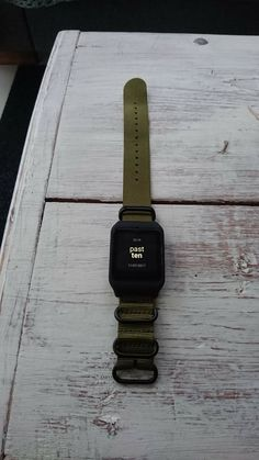 Sony smartwatch 3 with olive green nato watch strap.