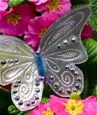 DIY- How to make a punched tin butterfly for a decoration or for the garden.  Could use soda cans.