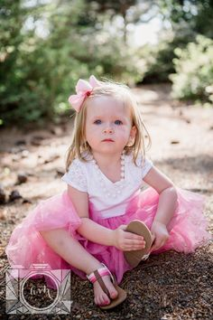 Little girl in her tutu sitting in the rocks at this family session at Baxter Gardens in Fountain City by Knoxville Wedding Photographer, Amanda May Photos
