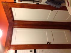 Doors in the bathroom with trim stained and poly'd.  We got both of these doors from Community Forklift.