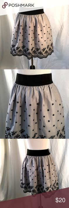 """Rhapsody Skirt Adorable gray skirt with black embroidered flowers. The unlined 100% cotton skirt has a scalloped embroidered hem and a 2"""" elastic waist band.  Approximate measurements:  Waist-30"""". Length-18"""". Rapsody Skirt Skirts Mini"""