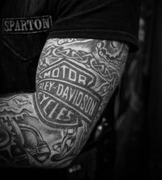 Amazing Celtic Design With Harley Bike Logo Tattoo On Sleeve