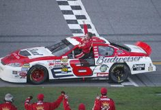 "Dale Jr. is climbing out of his Budweiser sponsored, Dale Earnhardt Inc. Chevy Monte Carlo SS after winning the 2004 Daytona 500, just ""3"" years after his father's tragedy."