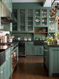 high ceilings, glass cabinet doors, copper pots