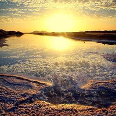"""My lips hold the prayer... in them as the rosebud holds fragrance in its Heart....."" Sunset over a salt evaporation pool in Siwa Oasis. Just come and experience the glory of a Siwa sunset.#justcome #thisisegypt #iregipto"