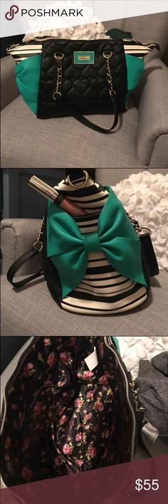 Betsey Johnson Purse Betsey Johnson Purse. Has pockets on side for easy access to phones or lip gloss. Comes with removable shoulder strap. Paid 85 for it. Betsey Johnson Bags Shoulder Bags