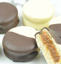 Black and White Alfajores for Cinco de Mayo - Alfajores are soft and delicate traditional shortbread cookies from South America.  Filled with Dulce de Leche, this sweet, melt in your mouth cookie dipped in dark and white chocolate makes it impossible to resist. #cincodemayo #cookies #chocolate