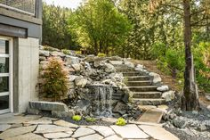 A serene waterfall connects the front and back yard.
