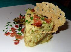 Risotto allo zafferano con carciofi, speck e cialda di parmigiano