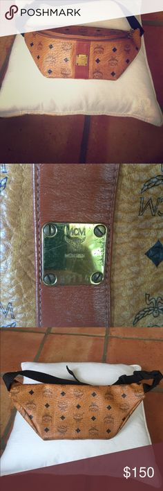 Vintage MCM tan fanny pack Very good used condition except for an interior stain (pictured) that cannot be seen from the outside. MCM Bags Clutches & Wristlets