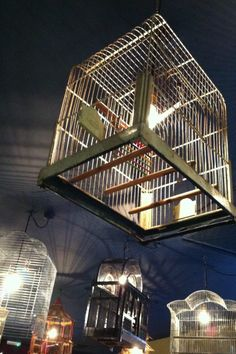 Beautiful bird cages adorn the ceiling of the restaurant