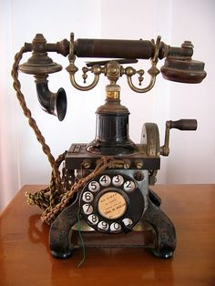 *VINTAGE TELEPHONE ~ The first telephones had to be hand cranked to generate the electricity before it could be sent across the phone line by the switchboard.