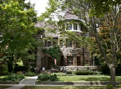 1202 W. Wayne Street - Castle Gallery  The local architectural firm of Wing & Mahurin designed this Richardsonian Romanesque house in 1905. The house exhibits massive stone construction, a prominent round tower, and crenelated parapet. The open front terrace originally was covered by a tile roof that matched that of the house.