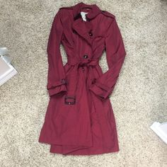 """Burberry Trench Coat  Never Worn  Authentic Burberry trench coat, cranberry color, Size 8, double breasted button up with belt, 37"""" from neck to hem, 18"""" inseam from armpit to end of sleeve. It is not lined. NEVER WORN. I have a cat in my home. Burberry Jackets & Coats"""