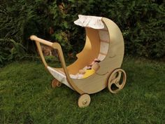 Adorable half moon pram lets tots stroll their dolls in style | Inhabitots
