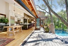 Creative patio ideas help personalize backyard designs and create comfortable outdoor seating areas. Modern backyard patio ideas offer beautiful materials that bring fabulous textures and colors into outdoor home decorating […] Indoor Outdoor Kitchen, Outdoor Kitchen Design, Patio Design, Outdoor Spaces, House Design, Outdoor Kitchens, Open Kitchens, Outdoor Patios, Outdoor Dining