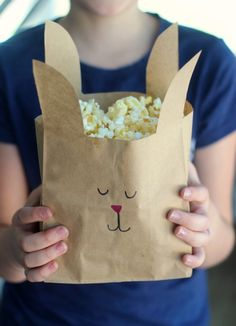Turn paper lunch sacks into adorable Easter bunny treat bags with just a few snips of the scissors. A quick and easy way to make your next movie night or party even more fun! Easter Crafts, Crafts For Kids, Easter Ideas, Easter Movies, Felt Bunny, Easter Bunny, Kids Lunch For School, Pre School, Bunny Bags