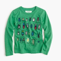This is not your garden-variety kind of T-shirt, thanks to a slew of glow-in-the-dark beetles. <ul><li>Cotton.</li><li>Long sleeves.</li><li>Machine wash.</li><li>Import.</li></ul>