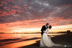 Love the cloud pattern and the beautiful sunset colors. Love the pose where the bride is slightly arched back while the couple kiss.