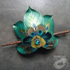 Peacock Feather Fan Large Leather Hair Slide With Featherwork And Beaded Cabochon. $55.00, via Etsy.
