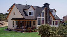 Casa Montreal - Vivienda de madera diseñada y construida por Canexel Construcciones - Destaca el gran ventanal del salón chimenea - 293m2