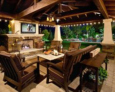 Impressive Patio Design Ideas - Style Motivation A big screen TV under a covered patio would be such a great addition to your backyard!A big screen TV under a covered patio would be such a great addition to your backyard! Outside Living, Outdoor Living Areas, Outdoor Rooms, Outdoor Patios, Outdoor Dining, Modern Outdoor Living, Outdoor Stone, Outdoor Seating, Indoor Outdoor