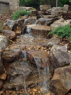 Waterfall and stream created by Hoaglandscape in Belmont, NC. #WaterfallWednesday