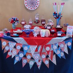 For this candy buffet in school colors, we used apothecary jars, vintage clear glassware, and colored glass in red and blue to hold tons of red, white, and blue candy!
