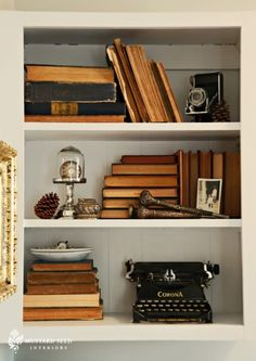 book shelf trend - pages facing out as opposed to the binding. Must buy more old books at the flea market.